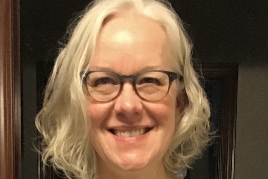 Photo of Professor Alison Gates smiling with glasses