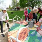Nicolette Welter and her husband, Brian, play with ther children - square